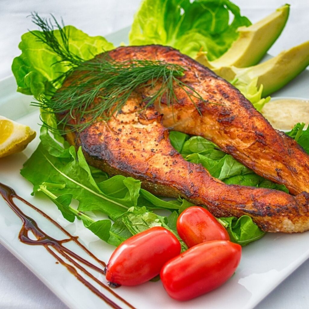 Cooked Fish with lettuce and tomato